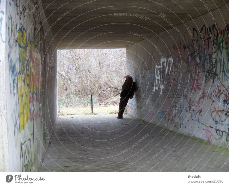 Waiting Loneliness Light Man Tunnel Pedestrian underpass Underpass Human being Shadow graffiti