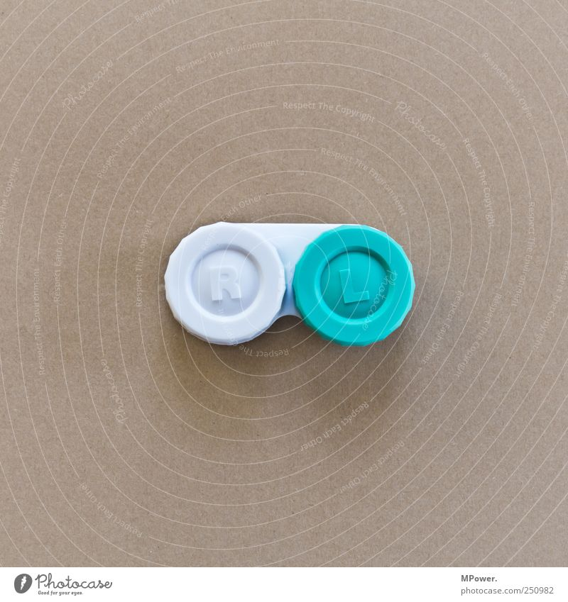 O_O Health care Brown White Carton Contact lense Right Left Distorted False Defective Round Plastic Colour photo Close-up Deserted Copy Space left
