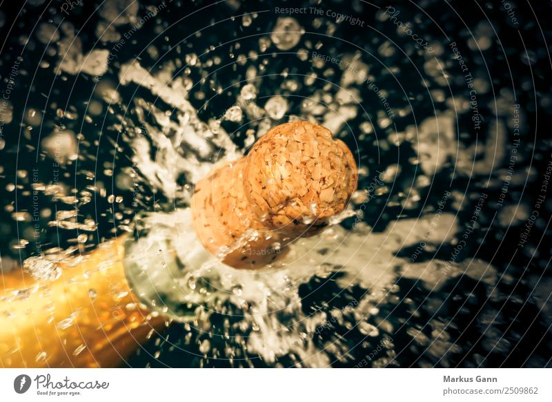 Champagne cork shoots from the champagne bottle Beverage Lifestyle Yellow Explosion Sparkling wine Cork Effervescent Inject Feasts & Celebrations Drinking