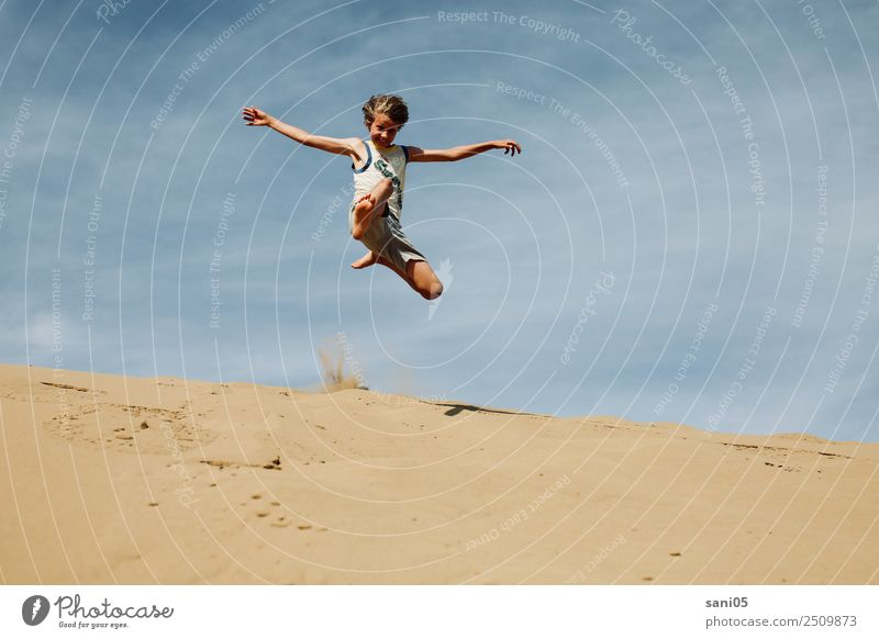 superjump Lifestyle Athletic Vacation & Travel Adventure Summer Boy (child) Body 1 Human being 8 - 13 years Child Infancy Climate Desert Sand Jump Infinity