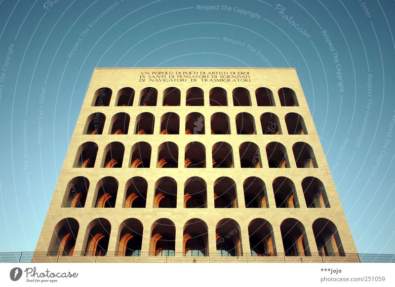 dice. Rome Modern Fascism Italy Colosseum Architecture Symmetry Monumental Landmark Column Archway Perspective Central perspective Block Concrete Neoclassicism