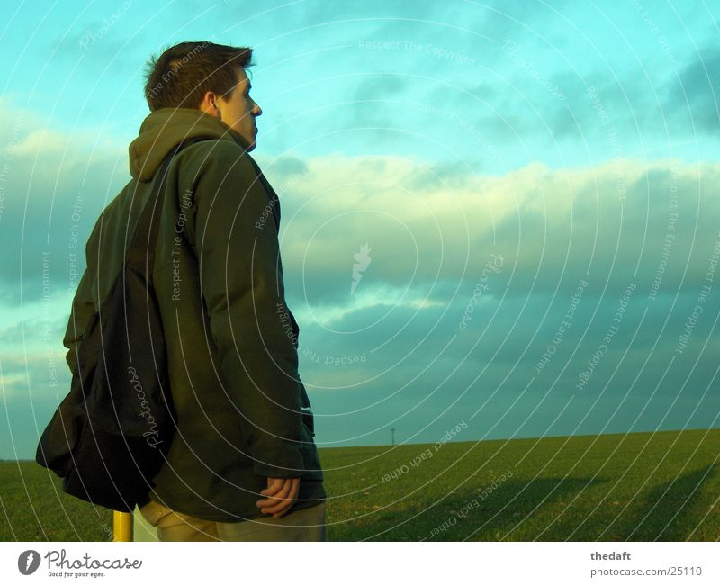 Man Sky Green Clouds Meadow Grass Think Concentrate Portrait photograph Darken Green space Young man