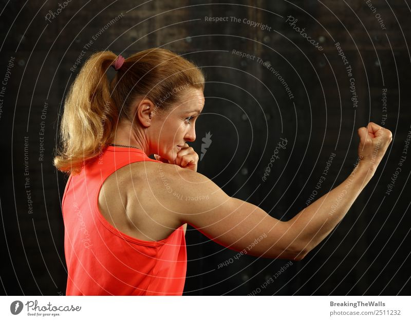 Profile portrait of woman boxing over black background Lifestyle Sports Fitness Sports Training Martial arts Sportsperson Success Woman Adults Arm Hand 1