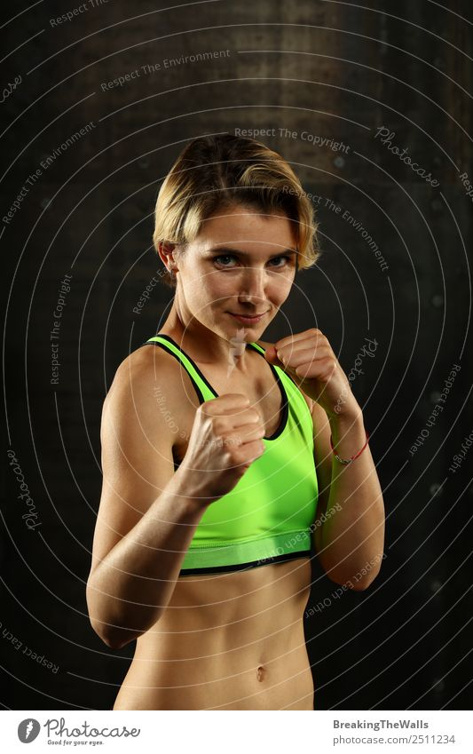 Young slim woman in boxing stance ready to fight Woman Human being Youth (Young adults) Young woman White Hand Dark 18 - 30 years Black Lifestyle Adults Sports