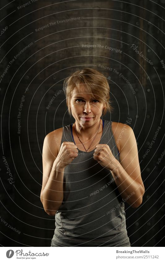 Close up portrait of woman in boxing stance Woman Human being Hand White Dark Black Face Adults Lifestyle Sports Blonde Power Arm Fitness Might Strong