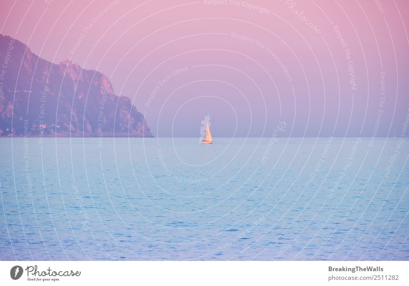Sunrise seascape with yacht on horizon Vacation & Travel Tourism Trip Summer Summer vacation Mountain Nature Landscape Water Sky Cloudless sky Horizon Rock