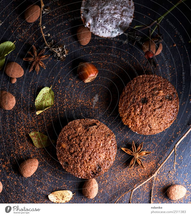 baked muffins on a black table Cake Dessert Candy Breakfast Table Wood Eating Fresh Small Above Brown Black Powder background Baking Bakery chocolate cooking