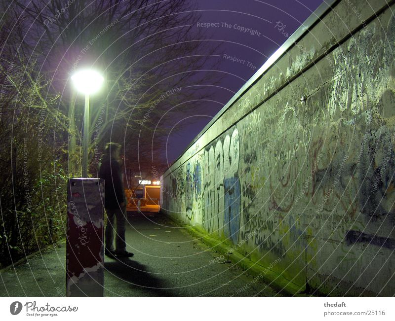 solitariness Wall (barrier) Light Loneliness Night Cold Winter Man Grief Distress Graffiti Human being