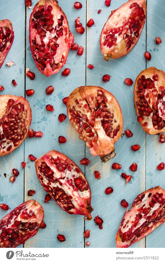 Pomegranate on blue wooden background Healthy Eating Blue Red Food photograph Wood Fruit Nutrition Fresh Vegetarian diet Diet Exotic Raw Organic