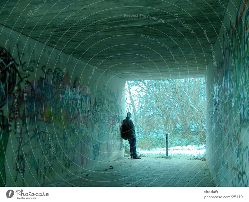 questionable Pedestrian underpass Loneliness Winter Masculine Tunnel Withdraw Mural painting Graffiti Man Underpass Snow Human being