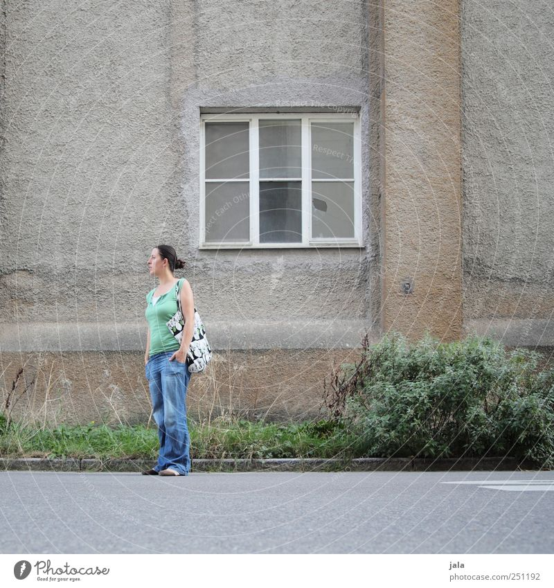 Human being Woman Plant House (Residential Structure) Adults Street Window Wall (building) Grass Wall (barrier) Building Facade Gloomy Bushes Manmade structures