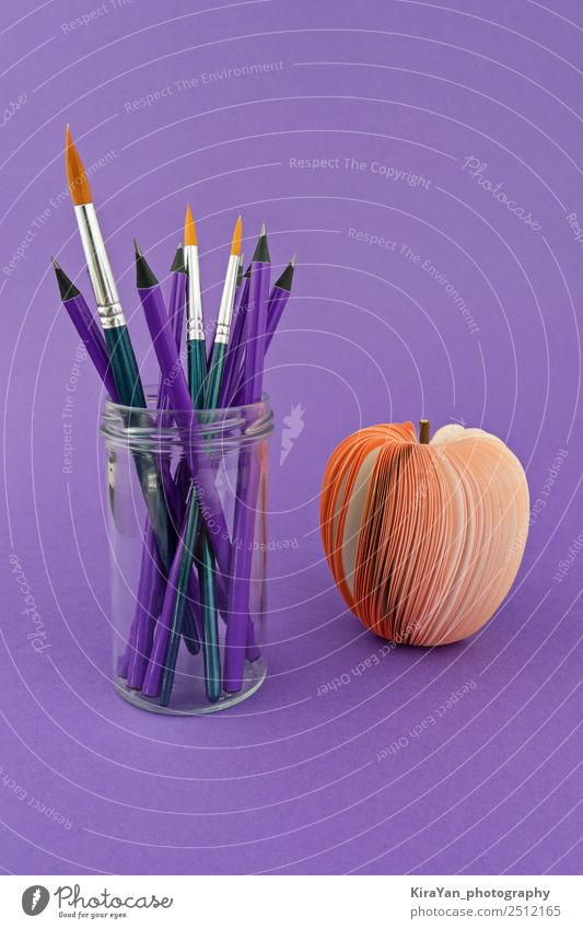 Glass cup with pencils and brushes on violet background Apple Style Design Leisure and hobbies School Academic studies Economy Tool Art Autumn Paper Pen Colour