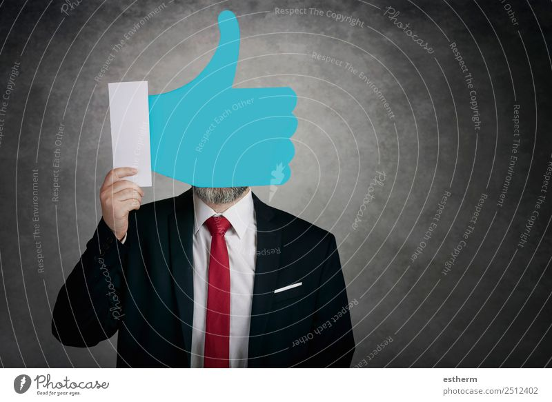 Businessman holding a like icon Lifestyle Joy Happy Technology Entertainment electronics Internet Human being Masculine Young man Youth (Young adults) Man
