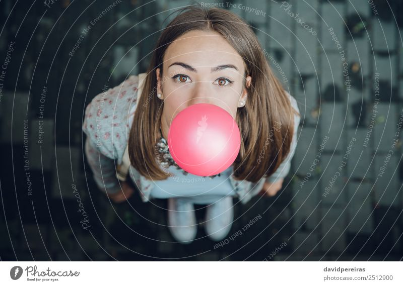 Young teenage girl blowing pink bubble gum Lifestyle Joy Happy Beautiful Face Human being Woman Adults Youth (Young adults) Mouth Lips Fashion Brunette Balloon