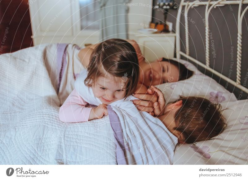 Little girl playing over boy lying in the bed Lifestyle Joy Happy Beautiful Relaxation Leisure and hobbies Playing Bedroom Child Baby Boy (child) Woman Adults