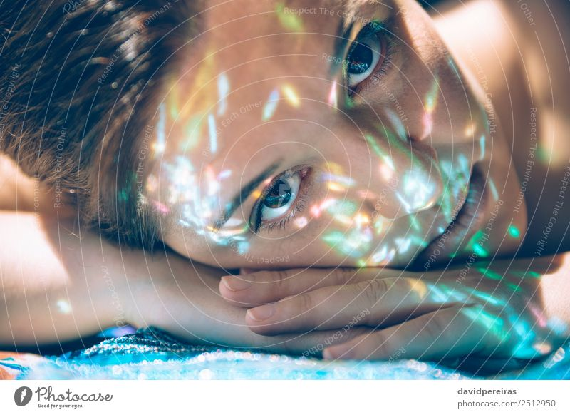 Woman face lying down over hands with colorful sparkles in skin Luxury Elegant Style Beautiful Skin Face Make-up Camera Human being Adults Hand Art Fashion