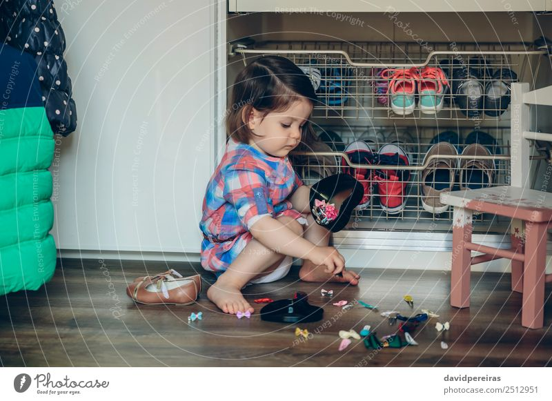 Baby girl playing with hair clips sitting in the floor Lifestyle Joy Happy Beautiful Playing House (Residential Structure) Child Human being Woman Adults