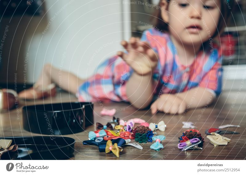 Baby girl playing with hair clips lying in the floor Lifestyle Joy Happy Beautiful Playing House (Residential Structure) Child Human being Woman Adults Infancy