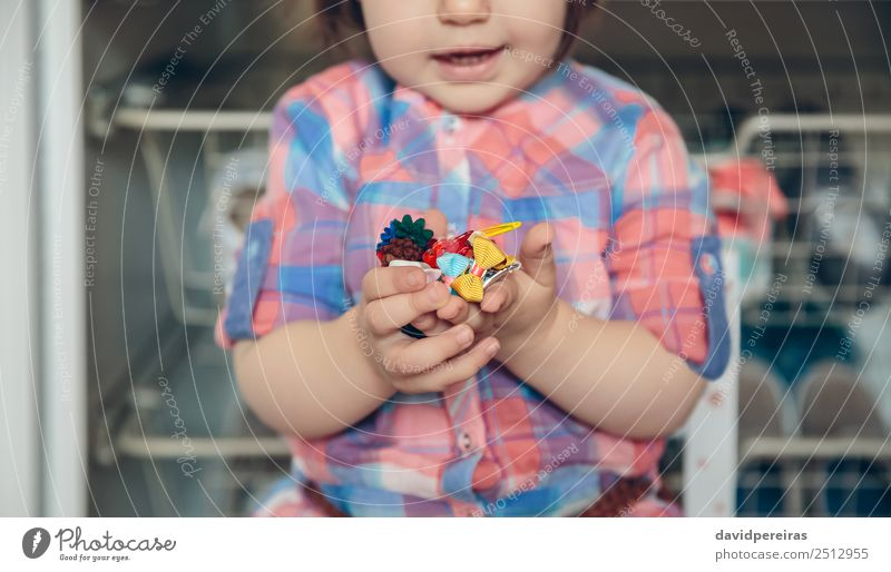 Baby girl playing with hair clips in the hands Lifestyle Joy Happy Beautiful Playing House (Residential Structure) Child Human being Woman Adults Infancy Hand