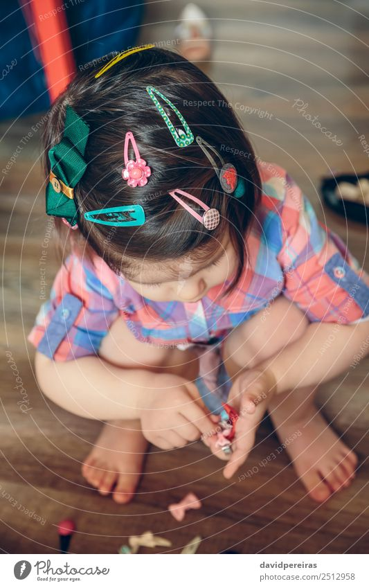 Baby girl head with a lot of hair clips Woman Child Human being Beautiful Hand Flower House (Residential Structure) Joy Adults Lifestyle Love Wood Happy Small