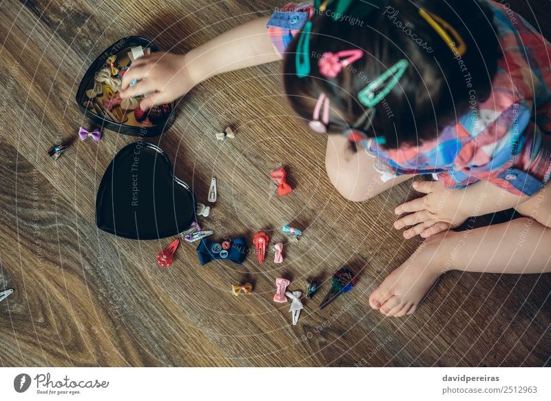 Baby girl playing with hair clips sitting in the floor Lifestyle Joy Happy Beautiful Hair and hairstyles Playing House (Residential Structure) Child Human being