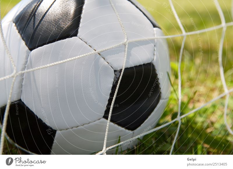 Soccer ball Joy Playing Sports Track and Field Ball Stadium School Schoolyard Grass Park Leather Green Black White Competition Action background circle