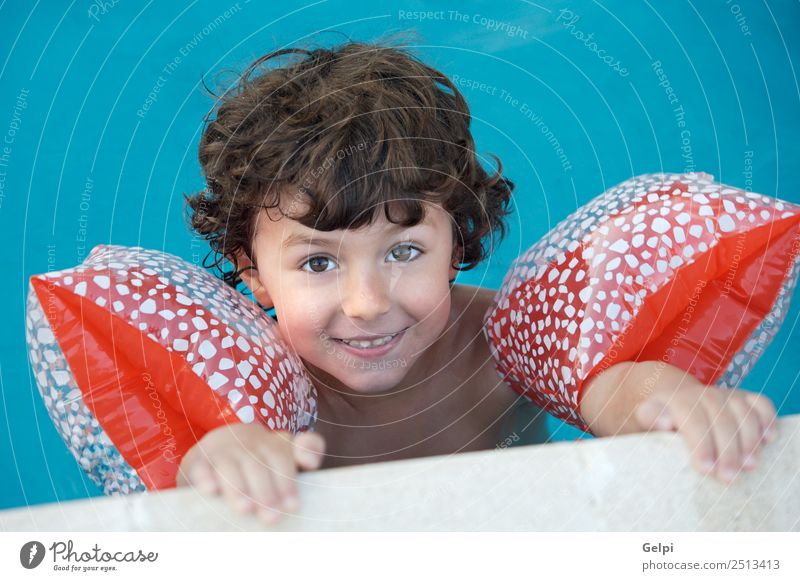 photo of an adorable boy learning to swim Beautiful Swimming pool Playing Vacation & Travel Summer Beach Ocean Child School Human being Baby Toddler Boy (child)