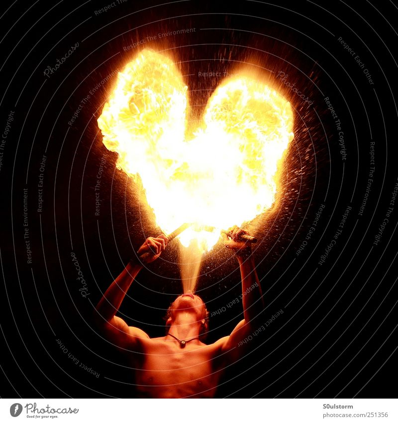 Human being Youth (Young adults) Red Black Yellow Emotions Warmth Feasts & Celebrations Heart Fire Esthetic Hot Firecracker Artist Young man