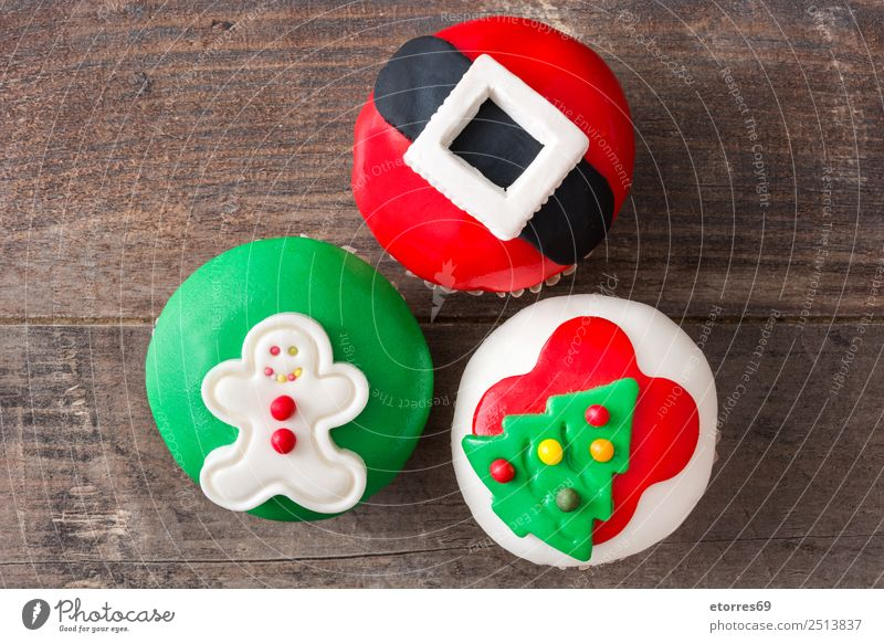Christmas cupcakes on wooden background Food Cake Dessert Healthy Eating Vacation & Travel Decoration Feasts & Celebrations Christmas & Advent Tree Hat Ornament