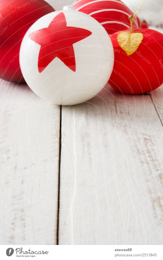 Christmas ornaments Christmas & Advent Ornament Sphere Round Red White Balloon Celebration of success Seasons Decoration Star (Symbol) Copy Space Wooden table