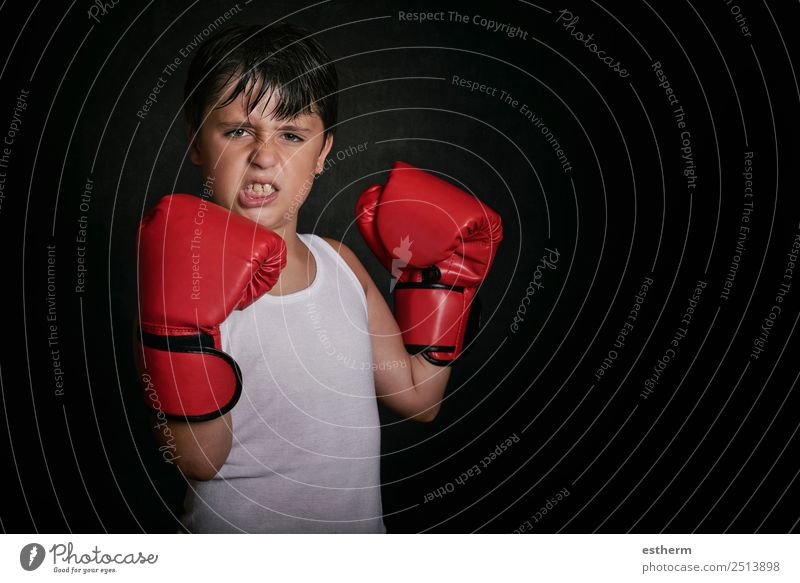 little boy with boxing gloves Child Human being Lifestyle Sports Boy (child) Masculine Power Infancy Success Fitness Threat Athletic 8 - 13 years Strong Anger
