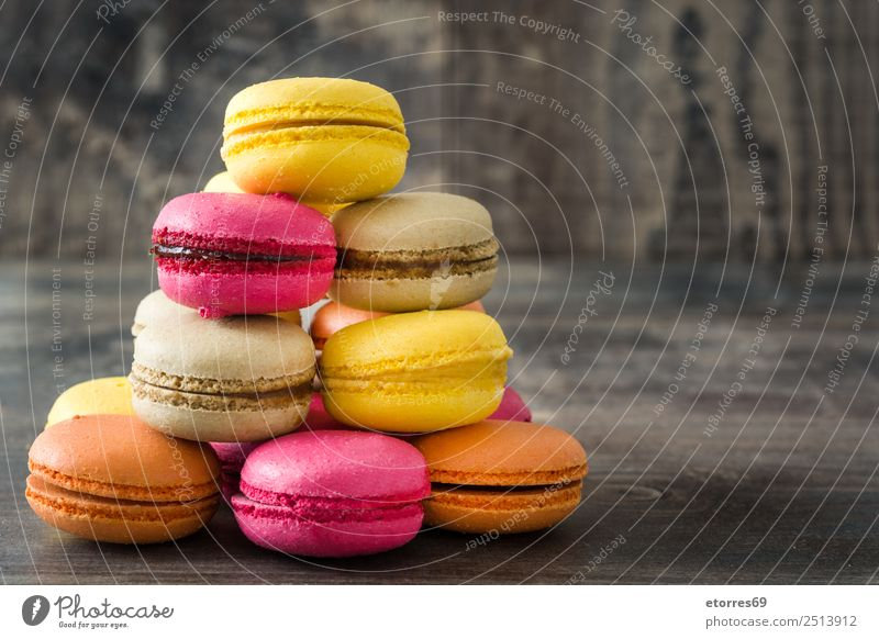 Colored macaroons on rustic wooden background Food Cake Dessert Healthy Eating Decoration Wood Delicious Sweet Pink Colour Tradition Macaron Candy