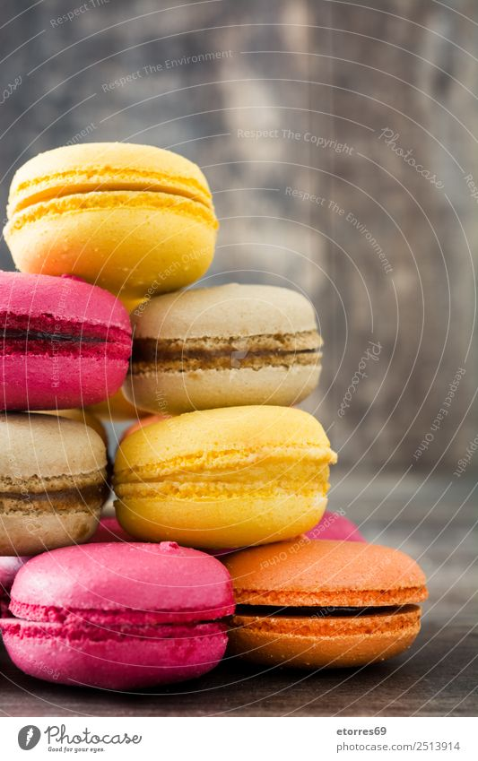 Colored macaroons on rustic wooden background Macaron Sweet Candy Food Food photograph Dessert French Delicious Snack Cookie Tradition Pink Wood Tasty Purple