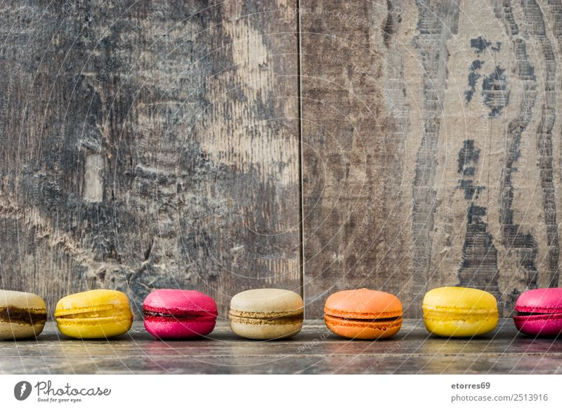 Colored macaroons on rustic wooden background Macaron Sweet Candy Healthy Eating Food photograph Dessert French Delicious Snack Cookie Tradition Pink Wood Tasty