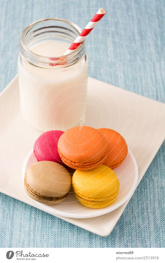 Milk and colored macaroons on blue background Macaron Sweet Candy Food Healthy Eating Food photograph Dessert French Delicious Snack Cookie Tradition Pink Wood