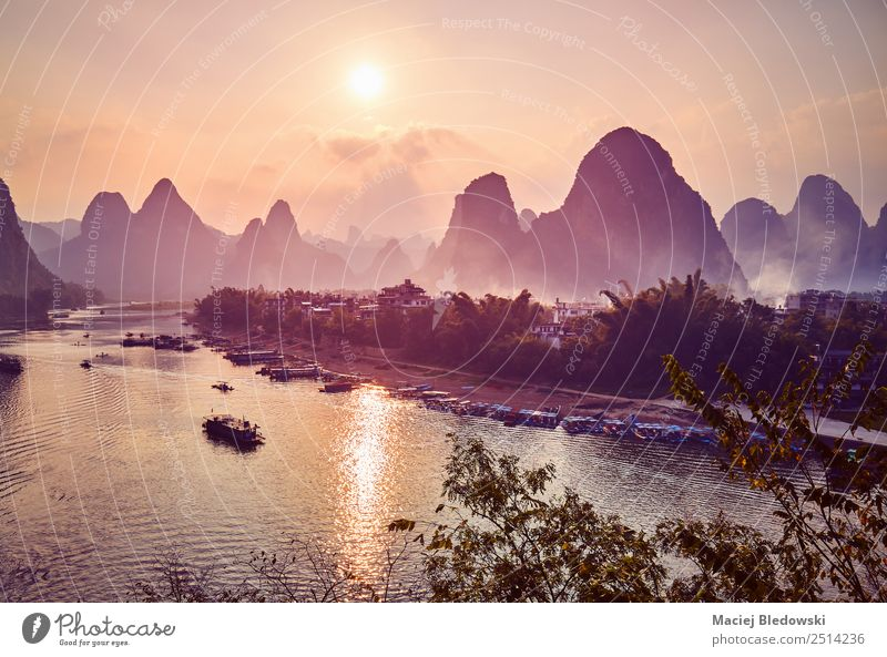 Scenic sunset over Li River in Xingping, China Vacation & Travel Tourism Trip Adventure Freedom Sightseeing Expedition Mountain Hiking Landscape Hill Village