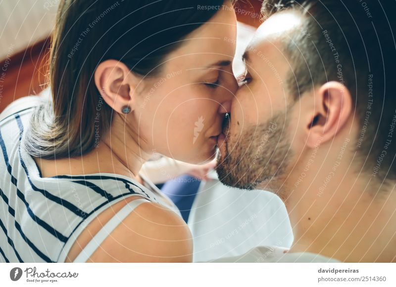 Top view of kissing couple Lifestyle Beautiful Face Human being Woman Adults Man Mother Family & Relations Couple Earring Beard Kissing Love Sit Authentic