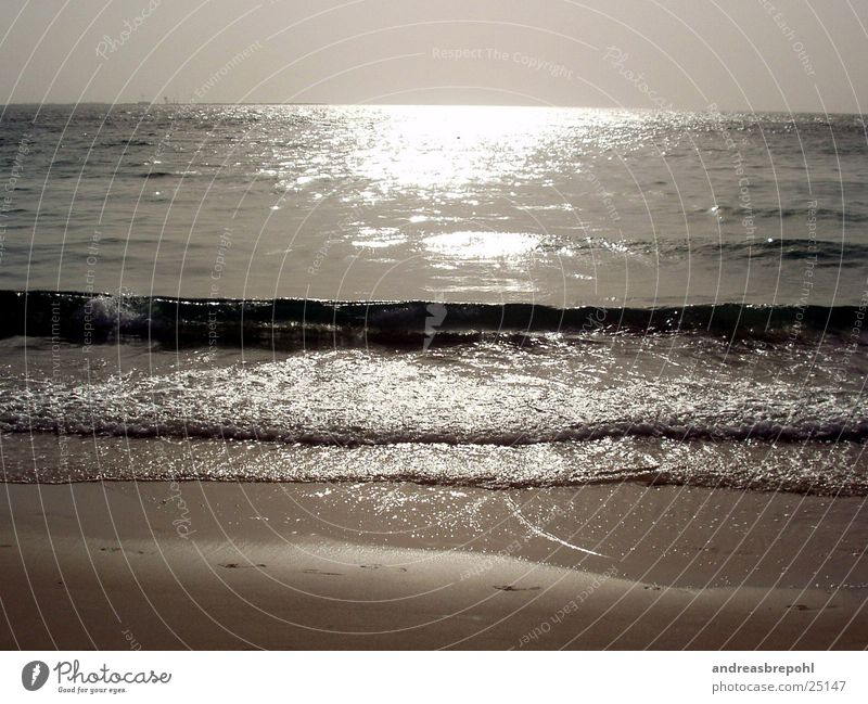 Water stop... what else? Horizon Waves Mirror To break (something) Beach Sun Reflection Sand