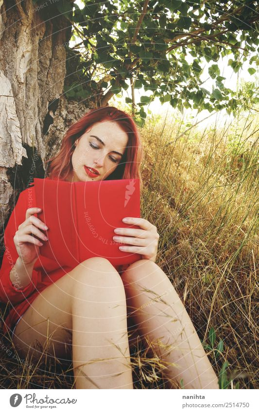 Young redhead woman reading a red book Lifestyle Beautiful Wellness Harmonious Well-being Senses Relaxation Leisure and hobbies Education Study Student