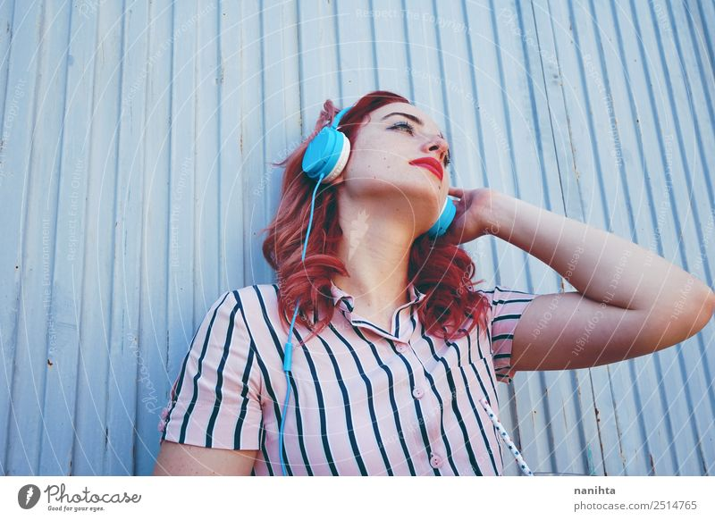 Young redhead woman listening to music Human being Youth (Young adults) Young woman Relaxation 18 - 30 years Adults Lifestyle Feminine Style Hair and hairstyles