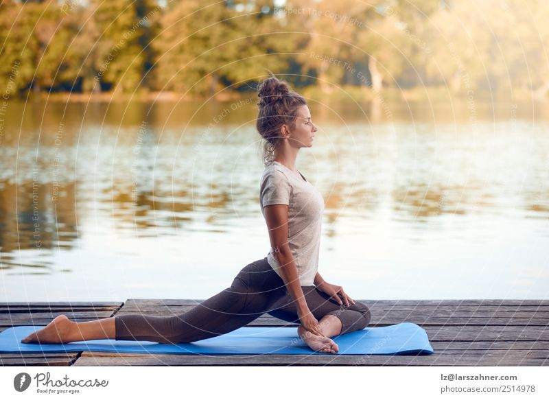 Attractive woman working out on a wooden deck Lifestyle Happy Beautiful Body Wellness Relaxation Meditation Summer Ocean Yoga Woman Adults 1 Human being