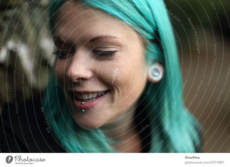 Young woman with turquoise hair and piercings smiles Style Exotic Beautiful Life Youth (Young adults) 18 - 30 years Adults Jewellery Piercing Long-haired Punk