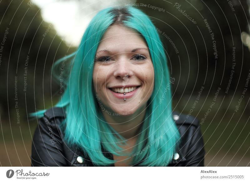 Portrait of a laughing young woman with turquoise hair Style already Life Young woman Youth (Young adults) 18 - 30 years Adults Landscape Park Leather jacket