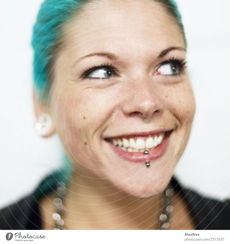 Young woman with turquoise hair and piercings smiles happily Style Exotic Beautiful Well-being Youth (Young adults) Face 18 - 30 years Adults Jacket Jewellery
