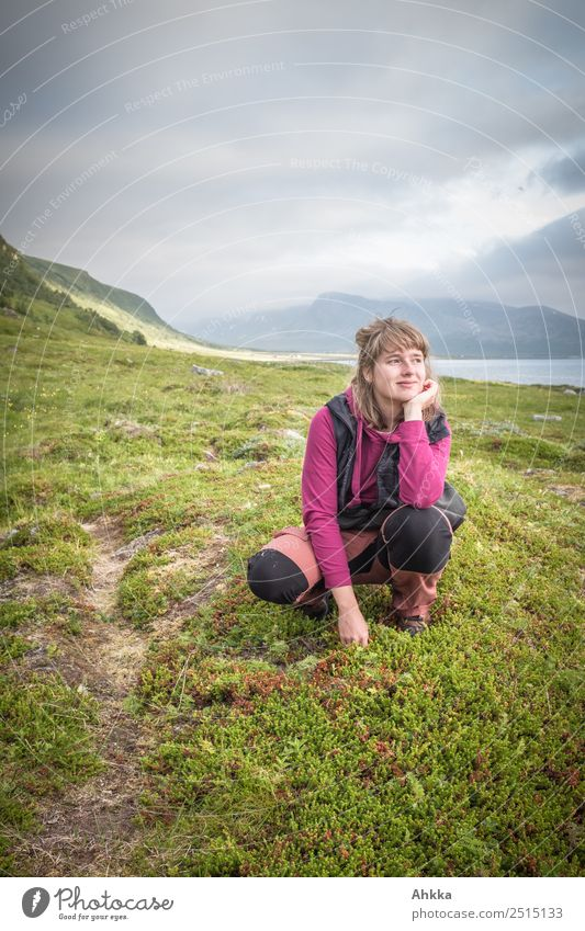 Young woman dreams in nordic landscape Well-being Contentment Relaxation Calm Vacation & Travel Trip Far-off places Freedom Summer vacation Mountain Hiking