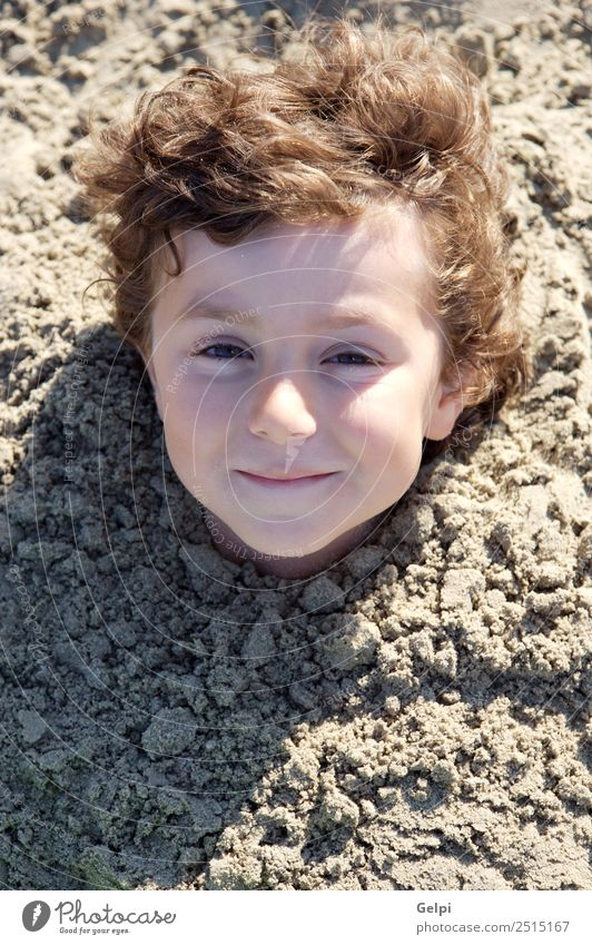 Small child buried in the sand of the beach Child Human being Sky Nature Vacation & Travel Man Summer Blue Colour Sun Ocean Red Joy Beach Face Adults