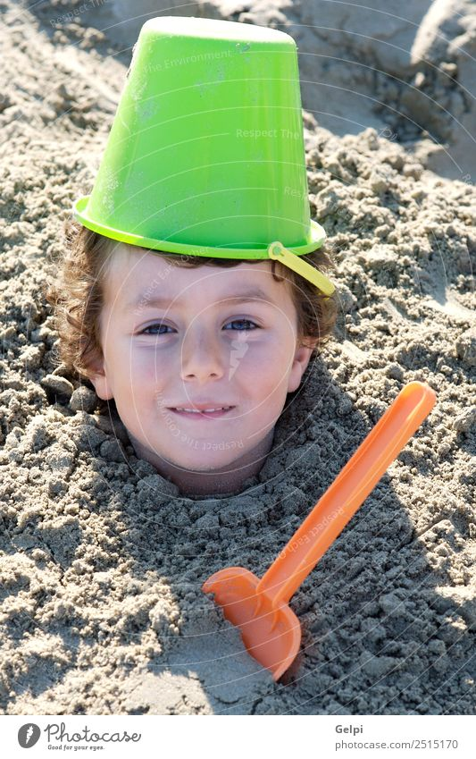 Small child buried in the sand of the beach Joy Happy Face Playing Vacation & Travel Summer Sun Beach Ocean Sports Child School Human being Boy (child) Man