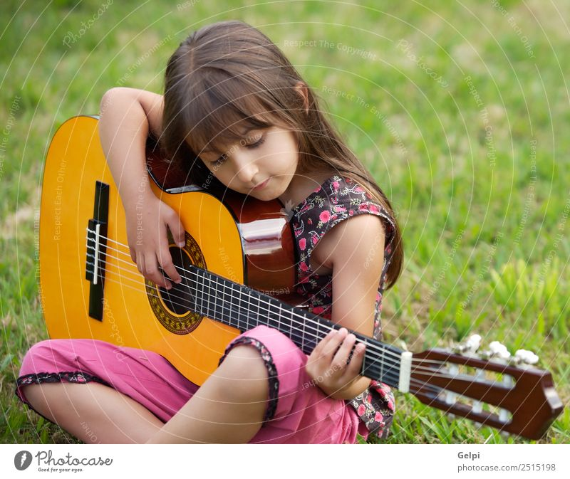 Girl with a guitar Music Child School Human being Boy (child) Guitar Musical notes Flower Grass Green Pink girl student spanish handsome people instrument