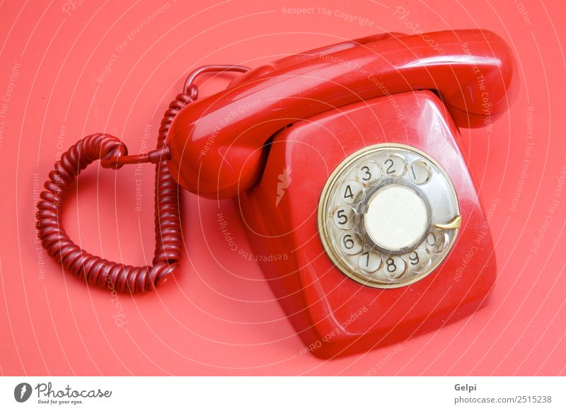 An old red telephone over red background Old Beautiful White Red To talk Office Line Communicate Technology Telecommunications Action Telephone Ring