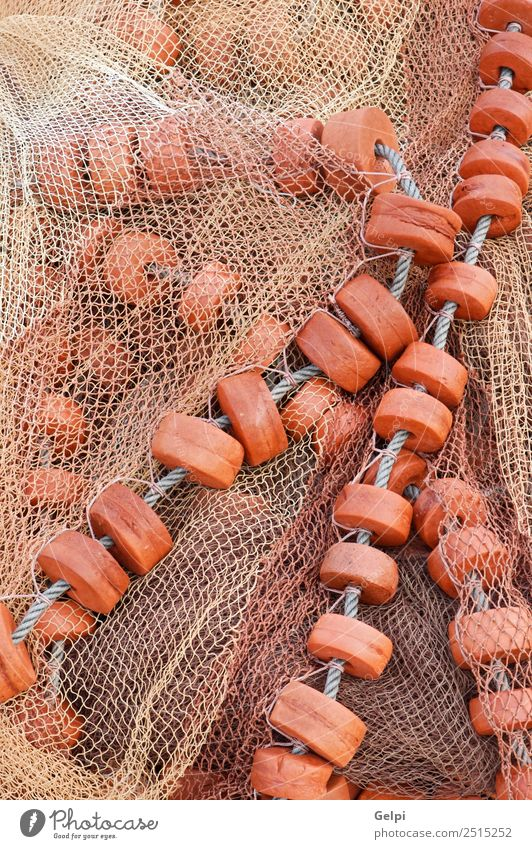 Detail of an old traditional fishing net Ocean Industry Rope Watercraft Tradition background ballast Buoy buoys catch cord cork craftsmanship drag equipment